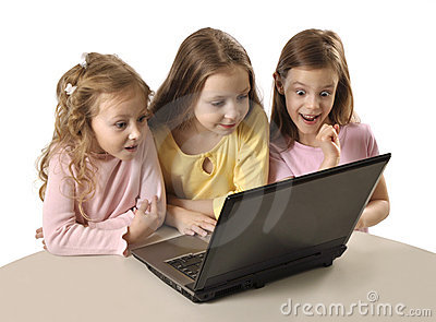 Three girls using laptop