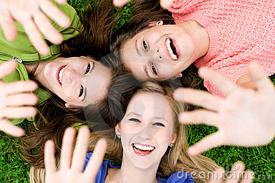 Three girls waving hands