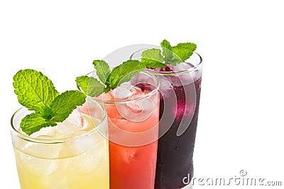 Three glass of apple,grape and strawberry juice