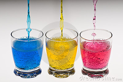 Three glasses with colored whater