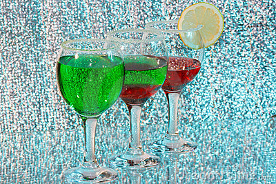 The three glasses of green and red liquor