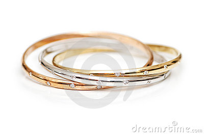 Three gold bracelets isolated