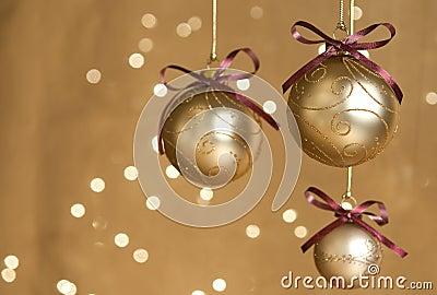 Three gold Christmas balls