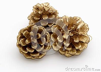 Three gold pine cones