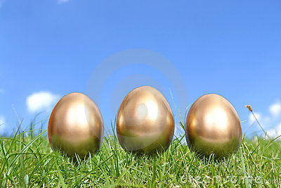 Three golden eggs in grass
