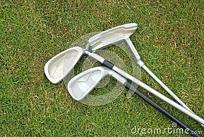 Three golf clubs