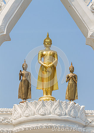 Free Three Graceful And Peaceful Golden Buddha Statues Standing Under Beautiful White Arch With Blue Sky Background Stock Images - 85998244