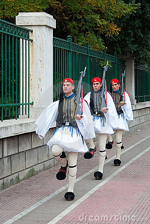 Three Greek guards marching in national costumes Editorial Image