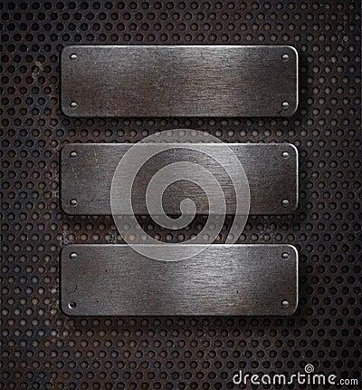 Three grunge rusty metal plates over grid