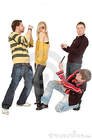 Three guys take photo of a posing girl by a mobile