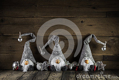 Three handmade funny santa claus of felt on old wooden backgroun Stock Photo