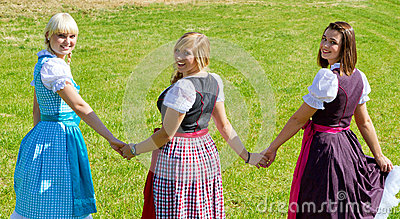 Three happy girls in Dirndl