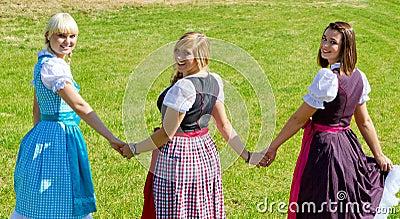 Three happy girls in Dirndl