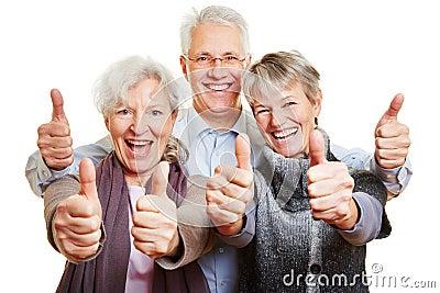 Three happy senior people holding
