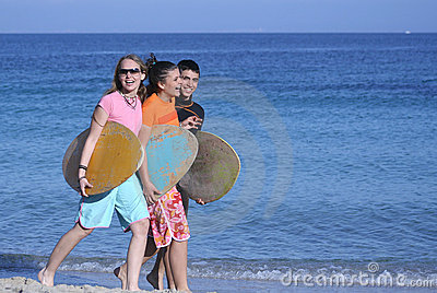three happy skim surfers