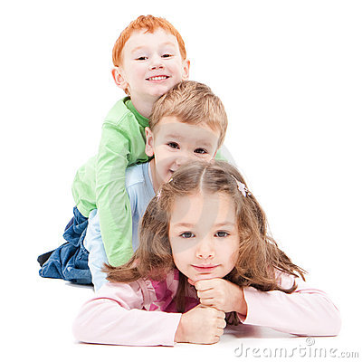 Free Three Happy Smiling Kids Lying On Pile Stack. Royalty Free Stock Photo - 19878705