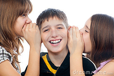 Three happy teenagers sharing a secret
