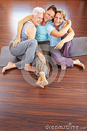 Three happy women in gym