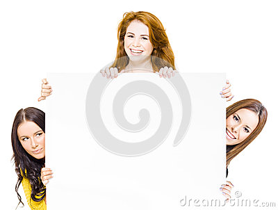 Three happy women with promotional sign