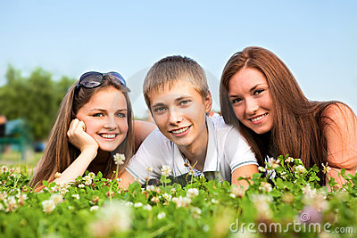Three happy young teenagers