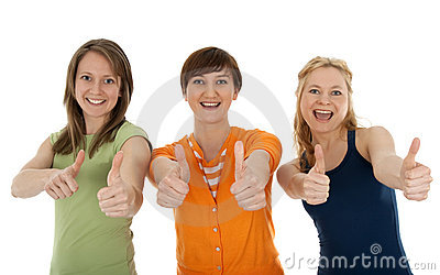 Three happy young women giving thumbs up