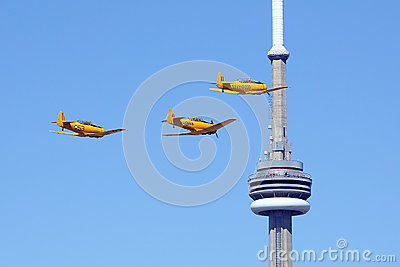 Three Harvard Aircraft fly by CN Tower Toronto Editorial Photo
