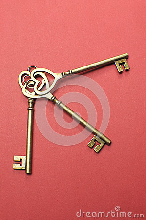Three heart shape gold keys - vertical.