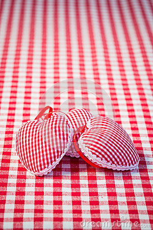 Three hearts on gingham tablecloth