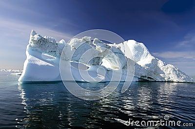 Three holes iceberg floating in Disko Bay