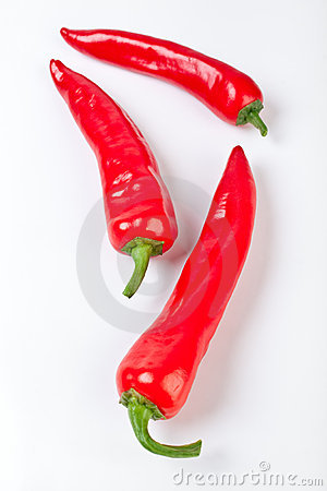 Three hot red chilly peppers