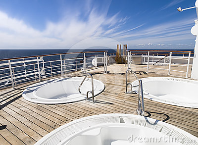Three hot tub on the deck of a cruise