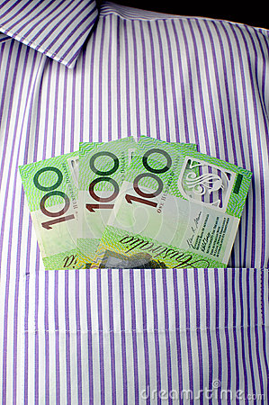 Three hundred dollar notes in business shirt pocket - vertical.