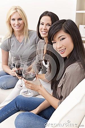 Three Interracial Women Friends Drinking Wine