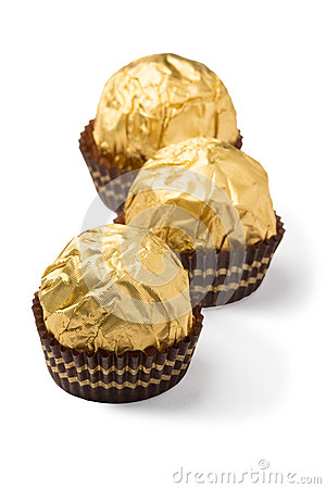 Free Three Isolated Chocolate Candies In Golden Foil Stock Image - 36503951