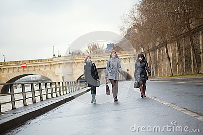 Three joyful girls walking in Paris