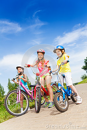 Free Three Kid Girls Holding Bicycles Outdoors Royalty Free Stock Photo - 43078805