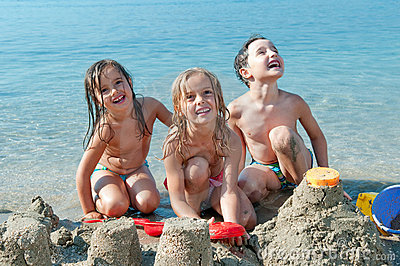Three Kids At The Beach Stock Photography - Image: 21191612