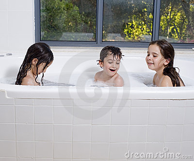 Three kids having a bath