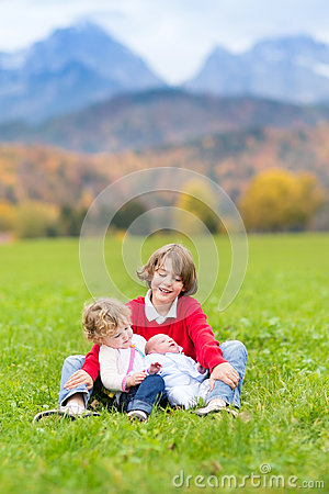 Free Three Kids In Beautiful Snow Covered Mountains Stock Photos - 41533123