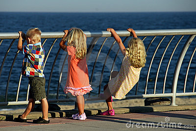Three Kids looking out to Sea