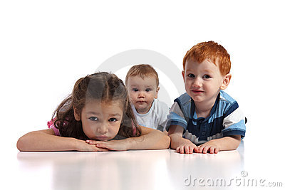 Three kids lying on floor