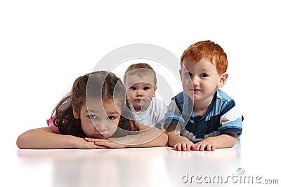 Three kids lying on floor