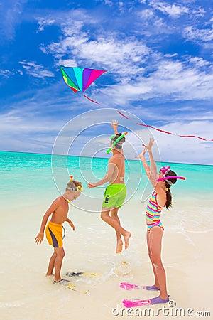 Three kids playing on beach