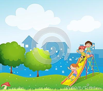 Three kids playing at the playground