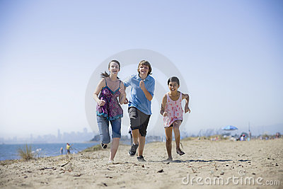 Three Kids Running on Beach