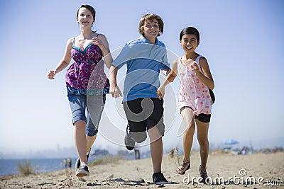 Three Kids Running on Beach