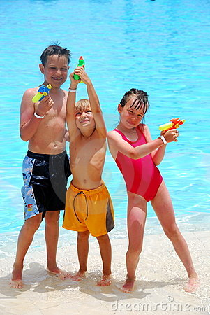 Three kids with squirt guns