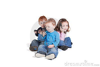 Three kids using mobile phones