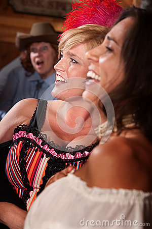 Three Laughing Women in a Saloon