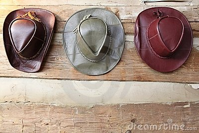 Three leather cowboy hats